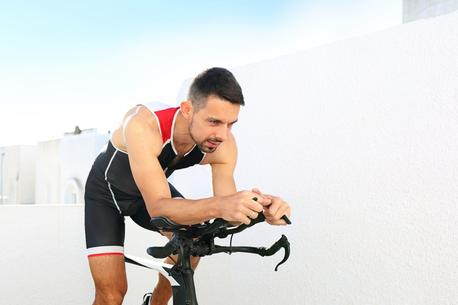 Caucasian Man Working Out On A Bike Outside Arbor Vita8