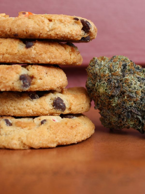 Cookie Edibles And A Cannabis Bud On A Wooden Table Arbor Vita8