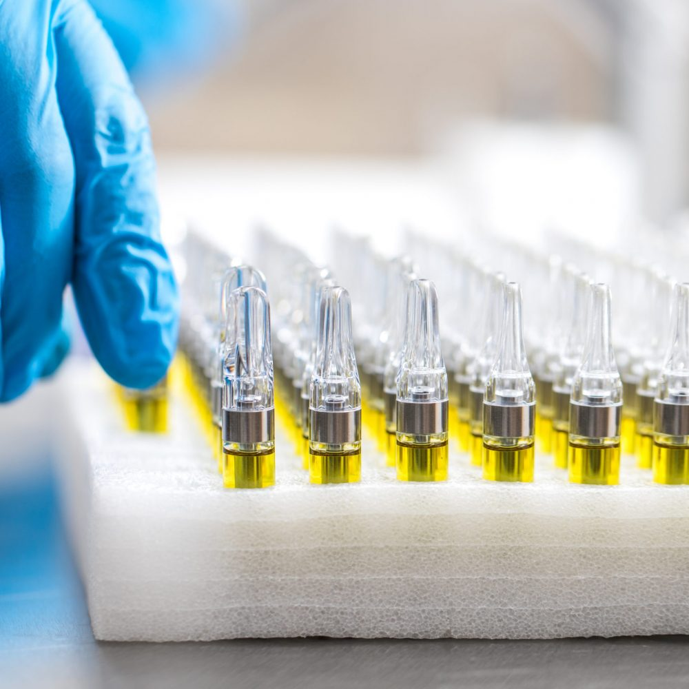 Distillate Cartridges Being Tested By A Lab Technician Arbor Vita8